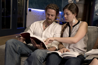 Man and woman looking at a sacred text